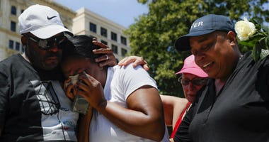 Mourners gather at a vigil following a nearby mass shooting, Sunday, Aug. 4, 2019, in Dayton, Ohio.