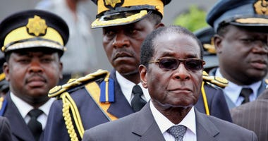 Zimbabwe President Robert Mugabe arrives for the burial of a prominent member of his party, Misheck Chando, in Harare, on Sat. Oct. 31, 2009.