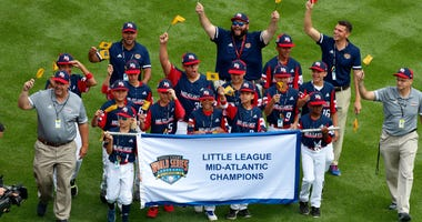 In this Aug. 15, 2019, file photo, the Mid-Atlantic Region Champion Little League team from Elizabeth, N.J. participates in the opening ceremony of the 2019 Little League World Series baseball tournament in South Williamsport, Pa.