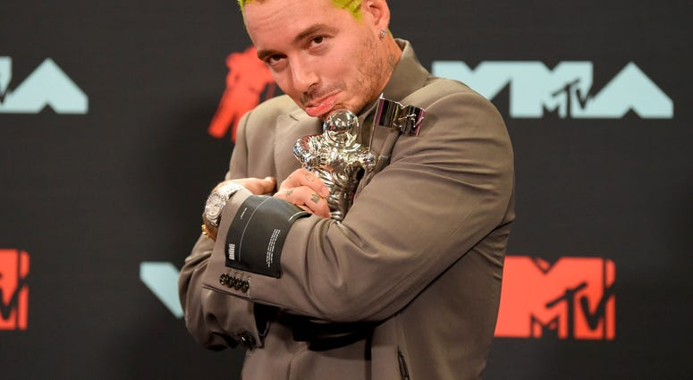 "J Balvin poses in the press room with the award for best latin video for ""Con Altura"" at the MTV Video Music Awards at the Prudential Center on Monday, Aug. 26, 2019, in Newark, N.J."