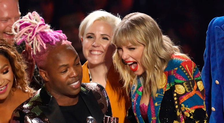 "Taylor Swift, right, accepts the video for good award for ""YouNeed to Calm Down"" at the MTV Video Music Awards at the Prudential Center on Monday, Aug. 26, 2019, in Newark, N.J."
