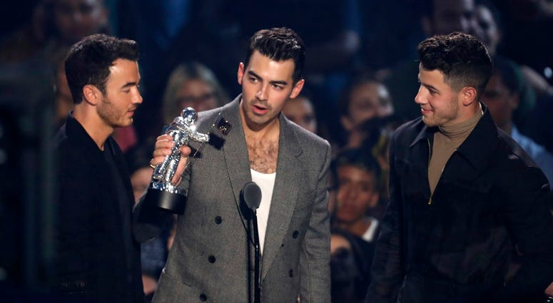 "Kevin Jonas, from left, Joe Jonas and Nick Jonas, of the Jonas Brothers accept the best pop award for ""Sucker"" at the MTV Video Music Awards at the Prudential Center on Monday, Aug. 26, 2019, in Newark, N.J."