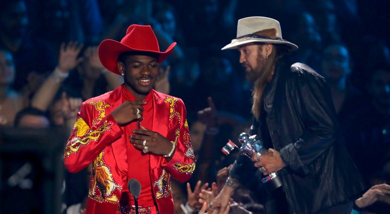 "Lil Nas X, left, and Billy Ray Cyrus accept the song of the year award for ""Old Town Road"" at the MTV Video Music Awards at the Prudential Center on Monday, Aug. 26, 2019, in Newark, N.J."