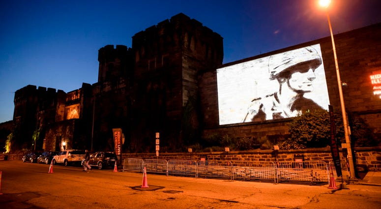 "A guest film by Dee Hibbert-Jones and Nomi Talisman, titled ""Last Day of Freedom"" is projected on the wall of Eastern State Penitentiary in Philadelphia."