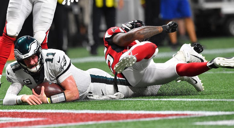 Philadelphia Eagles quarterback Carson Wentz (11) hits the turf near the goal line working for a two-point conversion against the Atlanta Falcons during the second half of an NFL football game, Sunday, Sept. 15, 2019, in Atlanta.