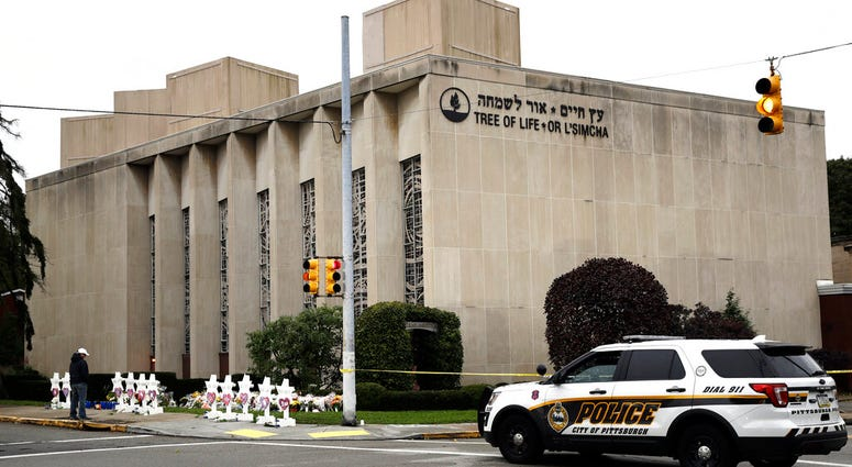 A  police vehicle is posted near the Tree of Life/Or L'Simcha Synagogue in Pittsburgh. Jewish leaders are preparing to discuss plans to commemorate the deadly shooting that killed 11 worshippers inside the synagogue almost a year ago.