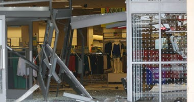 The damaged storefront of the Sears store at Woodfield Mall is seen after a man drove an SUV into the store in the Chicago suburb of Schaumburg, Ill..