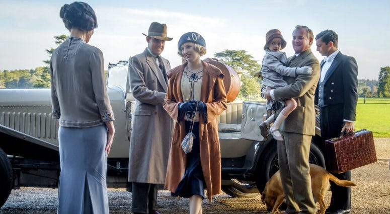 """This image released by Focus Features shows Elizabeth McGovern, from left, Harry Hadden-Paton, Laura Carmichael, Hugh Bonneville and Michael Fox, right, in a scene from the film """"Downton Abbey."""""""