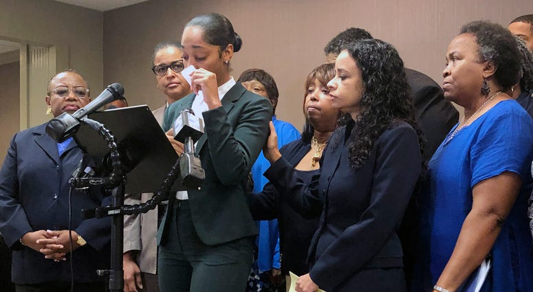 Jazmyne Childs cries during a news conference on Wednesday, Sept. 25, 2019, as she describes the sexual harassment she says she endured while employed by the North Carolina chapter of the NAACP, in Raleigh, N.C.