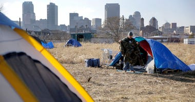 Terry, cleans out his tent at a large homeless encampment, near downtown St. Louis.