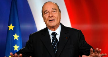 French president Jacques Chirac poses after recording a television address from the presidential Elysee Palace in Paris.