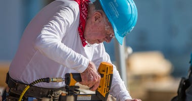 Former President Jimmy Carter works with other volunteers on site during the first day of the weeklong Jimmy & Rosalynn Carter Work Project, their 35th work project with Habitat for Humanity, in Mishawaka, Ind.