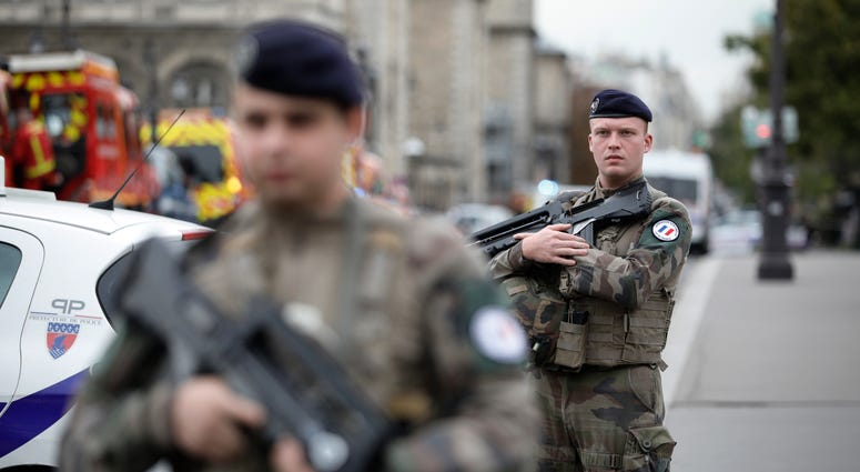 Armed soldiers patrol after an incident at the police headquarters in Paris, Thursday, Oct. 3, 2019. A French police union official says an attacker armed with a knife has killed one officer inside Paris police headquarters before he was shot and killed.