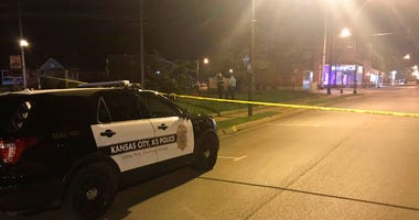 In this image from 41 KSHB Kansas City Action News police work the scene of a shooting outside a Kansas City, Kansas bar Sunday, Oct. 6, 2019.
