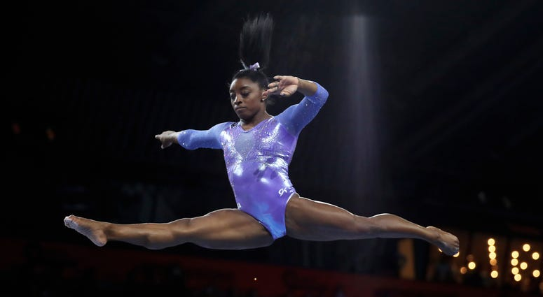 Gold medalist Simone Biles of the United States performs on the balance beam in the women's apparatus finals at the Gymnastics World Championships in Stuttgart, Germany, Sunday, Oct. 13, 2019.