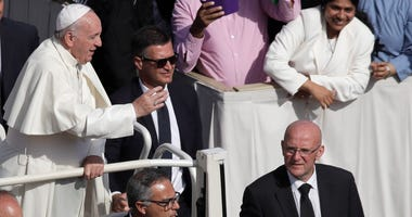 Vatican head of security Domenico Giani, right, with the pope.