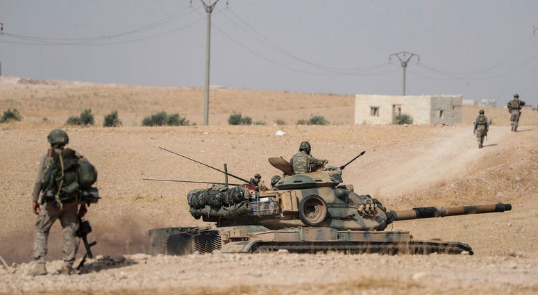 Turkish tanks and troops stationed near Syrian town of Manbij, Syria.
