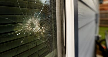 A bullet hole from the police officer's shot is seen in the rear window of Atatiana Jefferson's home on E. Allen Ave in Fort Worth, Texas, Tuesday, Oct. 15, 2019.