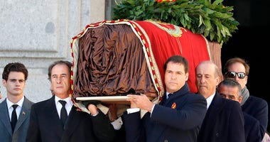 Relatives carry the coffin with the remains of Spanish dictator General Francisco Franco at the Valley of the Fallen mausoleum near El Escorial, outskirts of Madrid, Spain, Thursday, Oct. 24, 2019.