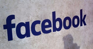 File photo shows a Facebook logo being displayed in a start-up companies gathering at Paris' Station F, in Paris.