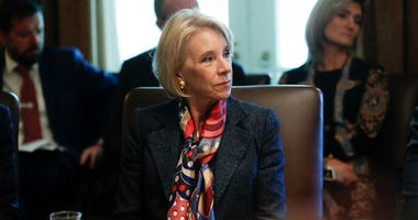 Education Secretary Betsy DeVos listens to President Donald Trump during a Cabinet meeting in the Cabinet Room of the White House in Washington.