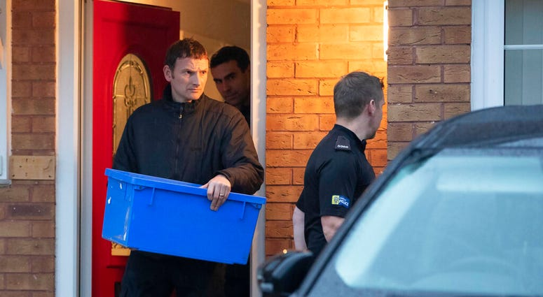 Police leave the home of Joanna and Thomas Maher with an evidence box at Wiltshire close in Warrington, Cheshire, Friday, Oct. 25, 2019.