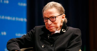 Supreme Court Justice Ruth Bader Ginsberg attends a panel with former President Bill Clinton and former Secretary of State Hillary Clinton.