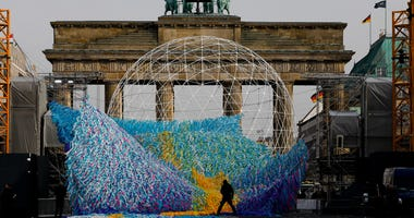 The skynet artwork 'Visions In Motion' is set to overhang the 'Strasse des 17. Juni' (Street of June 17) boulevard in front of the Brandenburg Gate in Berlin, Germany, Friday, Nov. 1, 2019.