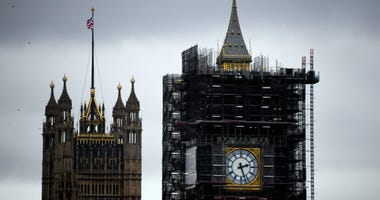 """A view of the Victoria Tower, left, and the Elizabeth Tower, which holds the bell known as """"Big Ben,"""" in London, Friday, Nov. 1, 2019."""