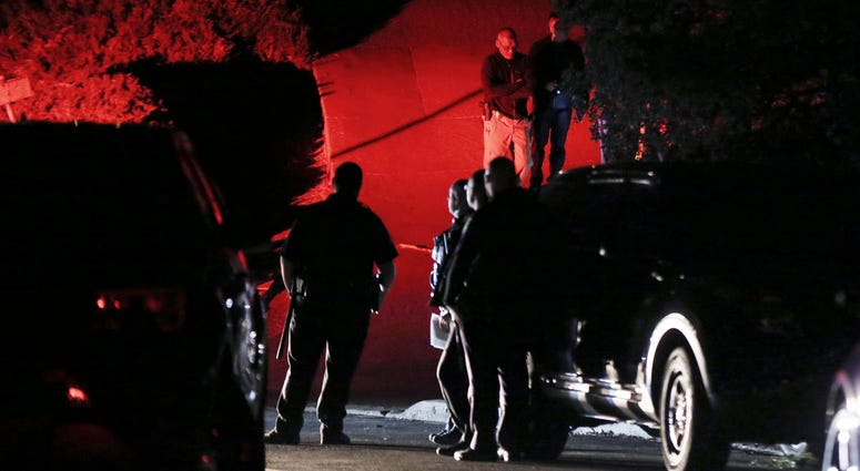 Contra Costa County Sheriff deputies investigate a multiple shooting in Orinda, Ca., on Thursday. Four people were killed and four others wounded in a Halloween night party shooting at a large rental home in a wealthy San Francisco Bay Area community.