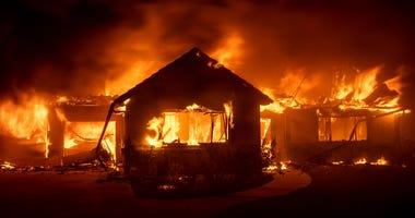 Flames from the Hillside Fire consume a home in San Bernardino, Ca.