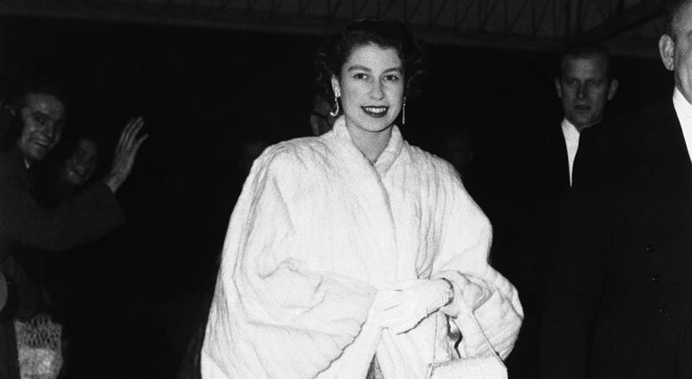 Britain's Queen Elizabeth II, wearing an ermine coat over her full-skirted evening dress, arrives at Royal Festival Hall in London to attend the St. Cecilia's Day concert on Nov. 28, 1952.