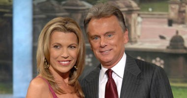 """File photo of co-host Vanna White and host Pat Sajak making an appearance at Radio City Music Hall for a taping of celebrity week on """"Wheel of Fortune"""" in New York."""