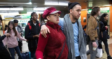 Luz Aurora Vidal and her son, Martín Batalla Vidal, line up to take a bus to Washington, Monday, Nov. 11, 2019, in New York.