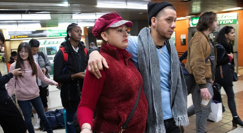 Luz Aurora Vidal and her son, Martín Batalla Vidal, line up to take a bus to Washington, Monday, Nov. 11, 2019, in New York.