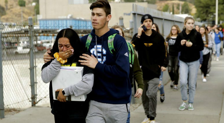 Students are escorted out of Saugus High School after reports of a shooting on Thursday, Nov. 14, 2019, in Santa Clarita, Calif.