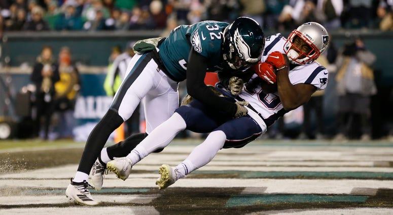 New England Patriots' Phillip Dorsett (13) hangs onto a touchdown pass against Philadelphia Eagles' Rasul Douglas (32) during the second half of an NFL football game against the Philadelphia Eagles, Sunday, Nov. 17, 2019, in Philadelphia.