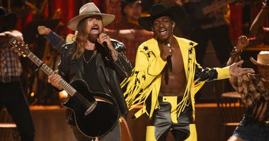 "Billy Ray Cyrus, left, and Lil Nas X perform ""Old Town Road"" at the BET Awards in Los Angeles."
