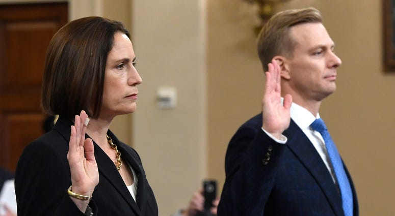 Former White House national security aide Fiona Hill, and David Holmes, a U.S. diplomat in Ukraine, are sworn in to testify before the House Intelligence Committee on Capitol Hill in Washington, Thursday, Nov. 21, 2019.