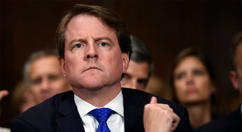 Then-White House counsel Don McGahn listens as Supreme Court nominee Brett Kavanaugh testifies before the Senate Judiciary Committee on Capitol Hill in Washington on Sept. 27, 2018..