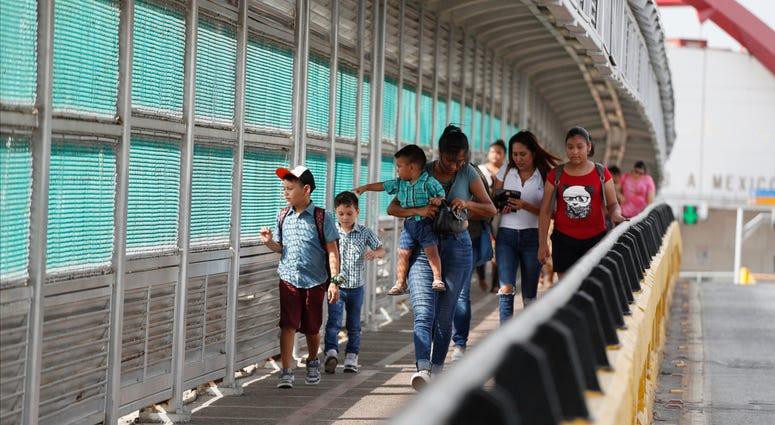 Local residents with visas walk across the Puerta Mexico international bridge to enter the U.S., in Matamoros, Tamaulipas state, Mexico.