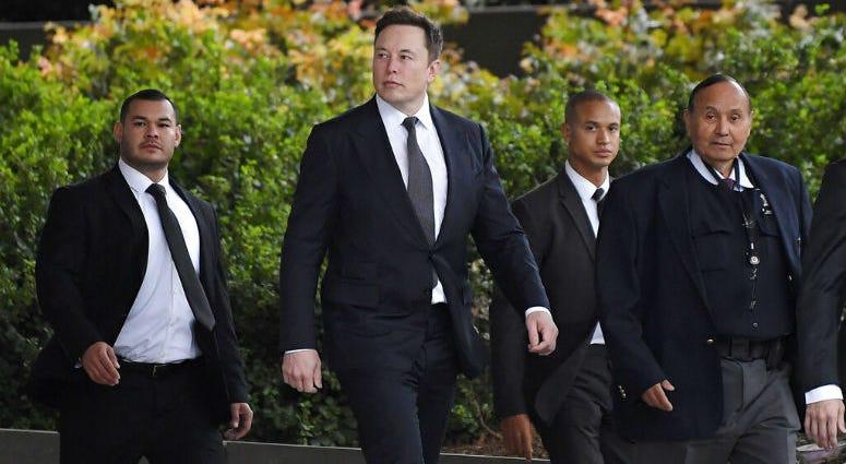Tesla CEO Elon Musk, second from left.
