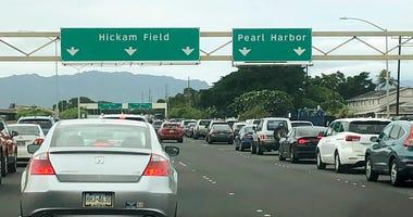 Traffic backs up at the main gates after a shooting at Pearl Harbor Naval shipyard, Wednesday, Dec. 4, 2019.