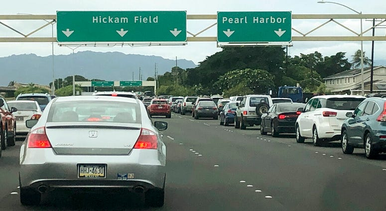 Traffic backs up at the main gates after a shooting at Pearl Harbor Naval shipyard, Wednesday, Dec. 4, 2019.