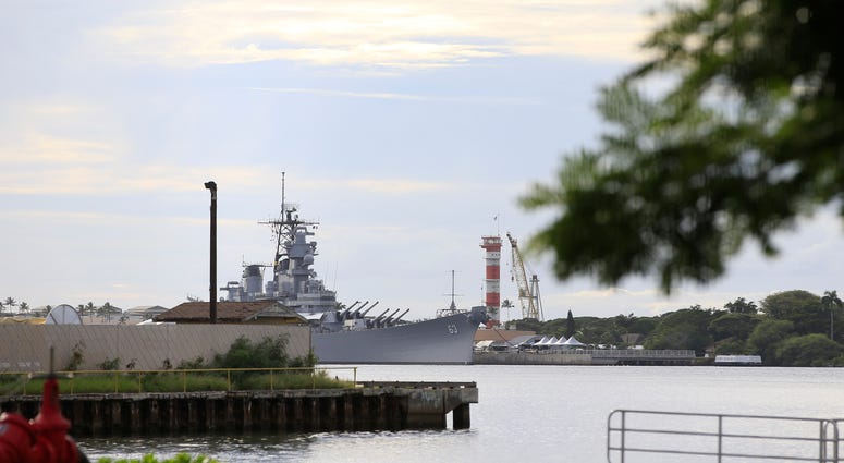 A U.S. naval ship can been seen from Pearl Harbor National Memorial Wednesday, Dec. 4, 2019, in Honolulu.