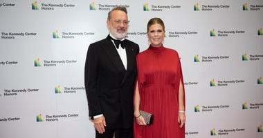 2014 Kennedy Center Honoree Tom Hanks and his wife, Rita Wilson, arrive at the State Department for the Kennedy Center Honors State Department Dinner on Saturday, Dec. 7, 2019, in Washington.