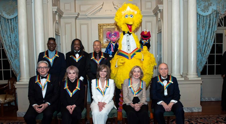 "Front row from left, 2019 Kennedy Center Honorees Michael Tilson Thomas, Linda Ronstadt, Sally Field, Joan Ganz Cooney, and Lloyd Morrisett, back row from left, Philip Bailey, Verdine White, Ralph Johnson, and characters from ""Sesame Street."""
