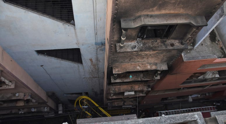 The walls of a building stand blackened after it caught fire in New Delhi, India, Sunday, Dec. 8, 2019.