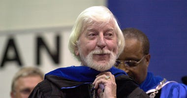 "Caroll Spinney, center, best known for his TV character ""Big Bird"" from Sesame Street, receives an honorary doctor of Humane Letters degree from Eastern Connecticut State University President David G. Carter, right."