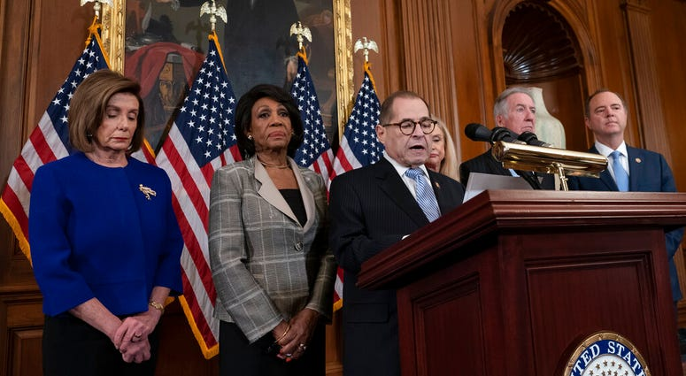Democrats announce they are pushing ahead with two articles of impeachment against President Donald Trump.